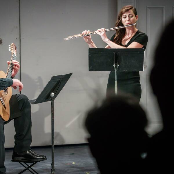 A flutist and guitar player perform for Breckenridge Music