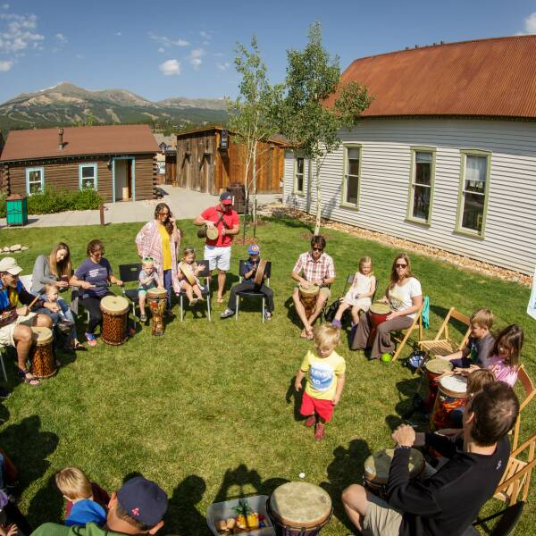 Children and adults playing in the drum circle at Breckenridge Music KidFest